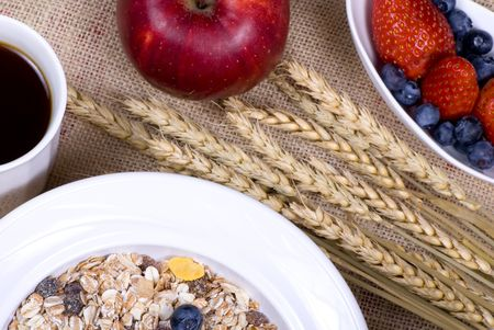 muslin: A bowl of muslin cereal with fresh fruits and coffee Stock Photo