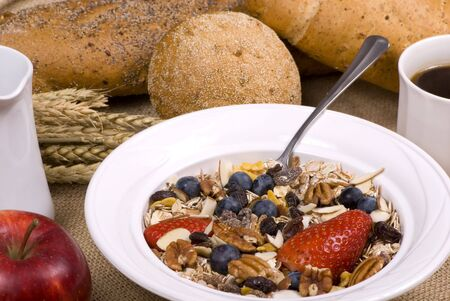 muslin: A bowl of muslin cereal with fresh fruits and bread. Stock Photo