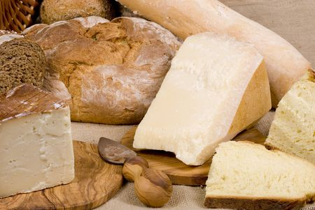 An assortment of fresh breads... straight from the oven..with cheese photo