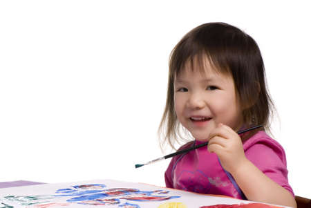 masterpiece: A young girl smiles as she paints her masterpiece Stock Photo