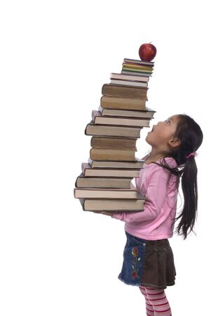The power of the future is your education. A young girl hold a tall tower of books.  photo