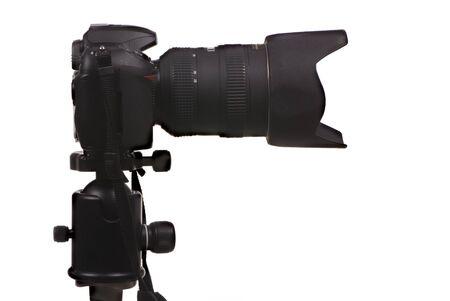 tripod mounted: A professional DSLR digital camera, mounted on a tripod and ready to shoot