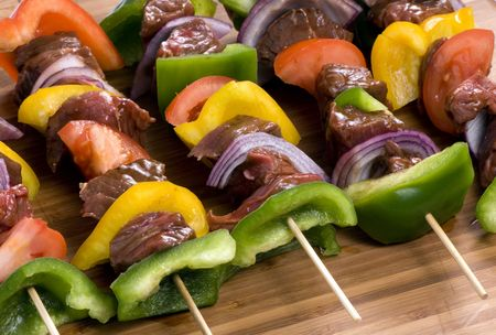 Preparing fresh beef steak shishkabobs with vegatables  photo