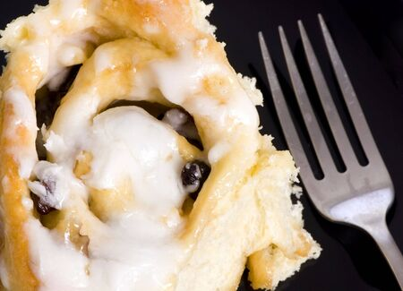 scrumptious: Making everybodys favorite... homemade cinnamon rolls with raisins and nuts.  Stock Photo