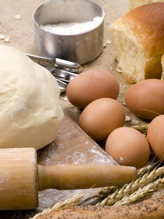 flatten: The preparations for making fresh homemade bread.