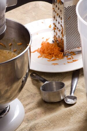 carrot cake: Making homemade carrot cake from scratch.  Stock Photo
