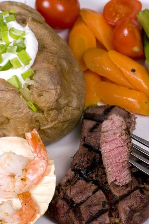 mouth watering: A mouth watering tenderloin steak with fresh vegetables and shrimp Stock Photo
