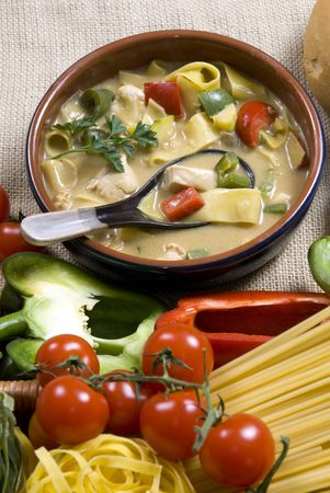Spicy homemade thai soup with chicken and fresh vegetables. photo