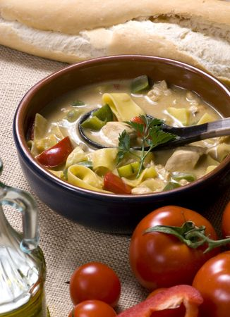Spicy homemade thai soup with chicken and fresh vegetables. Stock Photo - 821063