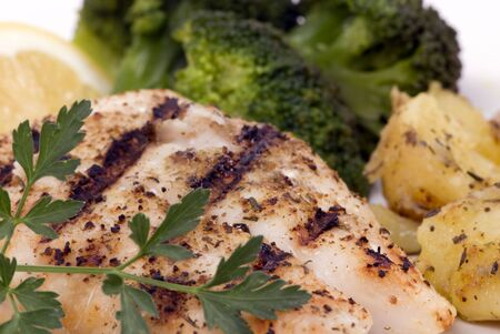 Fresh Red Snapper off the grill with vegetables and potatoes photo
