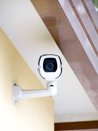 electronic survey: A security camera peers down at you... their watching you. Stock Photo