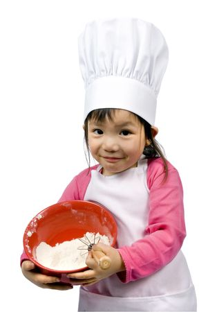 children cooking: A young girl having fun in the kitchen making a mess....I mean making cookies. Education, learning, cooking, childhood Stock Photo