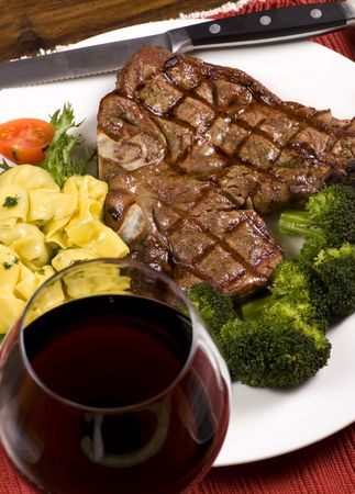 mouth watering: A mouth watering porterhouse steak with fresh vegetables and pasta