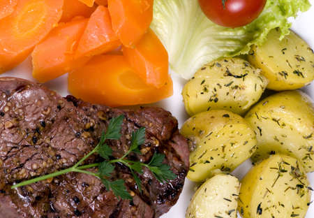 mouth watering: A mouth watering tenderloin steak with fresh vegetables and potatoes