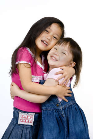 Two sisters share a special moment...if only for a second. Stock Photo