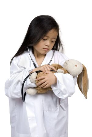 feeling up: A young girl having fun playing dress up as a doctor....How are you feeling?..... Education, learning, medical, childhood