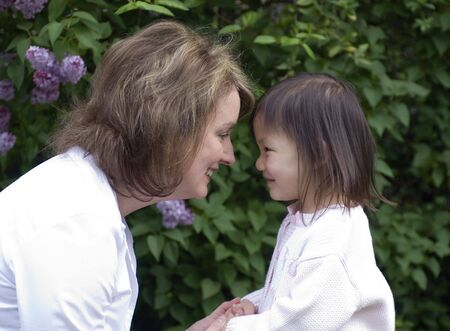 A mother and her adopted girl. Love affection bonding family Stock Photo