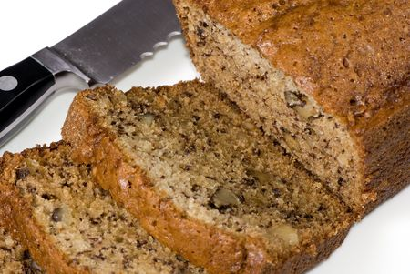 eat right: A loaf of fresh banana bread right out of the oven...sliced and ready to eat.