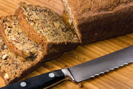 banana bread: A loaf of fresh banana bread with nuts.