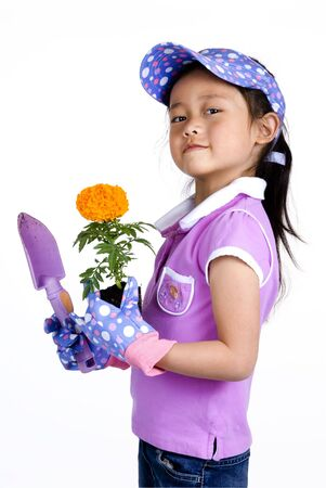 A young girl prepares to plant some springtime flowers