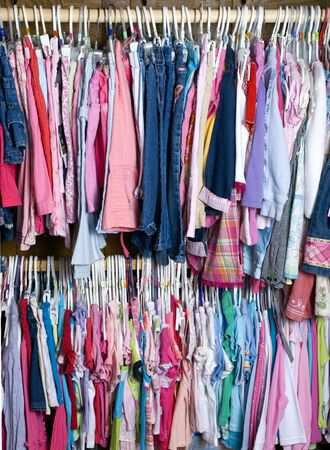 A young girls closet is stuffed full of colorful summer wear photo