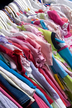 A closet stuffed full of colorful summer wear. photo