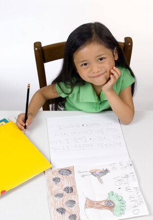 A young girl learning to read and write.
