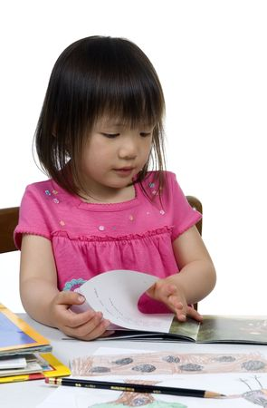 A young girl learns to read and write.
