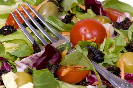 A health dinner salad with lots of greens.