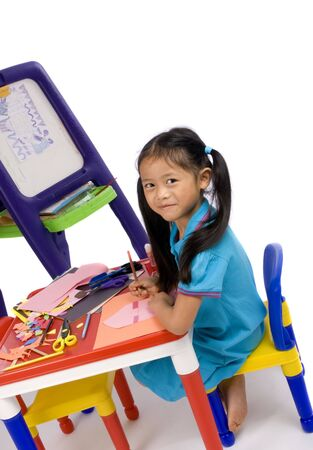 A young girl paints a picture. Family, love, bonding, education. Stock Photo - 960652