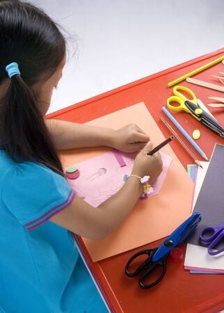 A young girl paints a picture. Family, love, bonding, education. Stock Photo - 960653