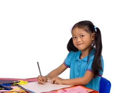 A young girl paints a picture. Family, love, bonding, education. Stock Photo - 960654