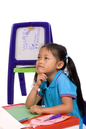 thinks: A young girl thinks about what to paint.... Family, love, bonding, education. Stock Photo