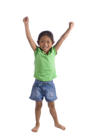 A young girl stands tall and raises her arms above her head....ya........... Stock Photo - 960673