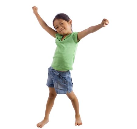kindergartener: A young girl stands with her arms out....success.