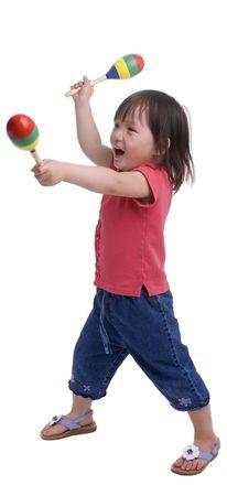ni�as jugando: Una ni�a que crecen. Infancia y aprendizaje, exploraci�n, la m�sica.  Foto de archivo