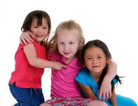Three young girls growing up. Childhood, learning, exploration