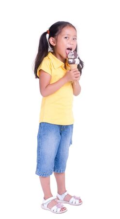 A young girl with a summertime treat. Ice cream cone.