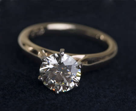 A very large diamond wedding ring on a black background Stock Photo