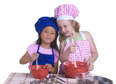 A young girl having fun in the kitchen making a mess....I mean making something special..... Education, learning, cooking, childhood