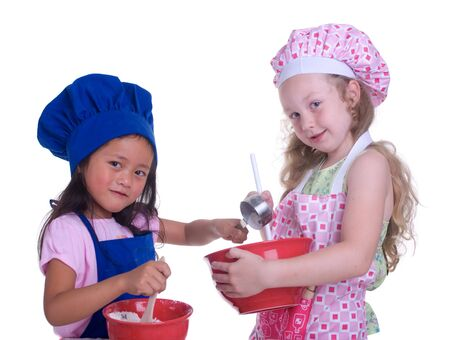 special education: A young girl having fun in the kitchen making a mess....I mean making something special..... Education, learning, cooking, childhood