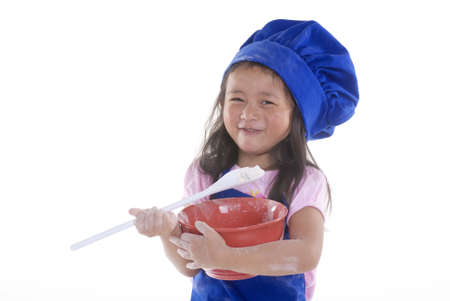 A young girl having fun in the kitchen making a mess....I mean making something special..... Education, learning, cooking, childhood Stock Photo - 1351748