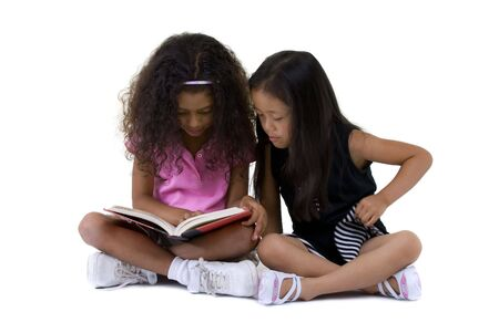 Going to school is your future. Education, learning, teaching. two young girls share a book.