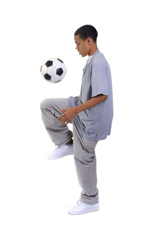A young boy playing with a soccer ball.   Standard-Bild
