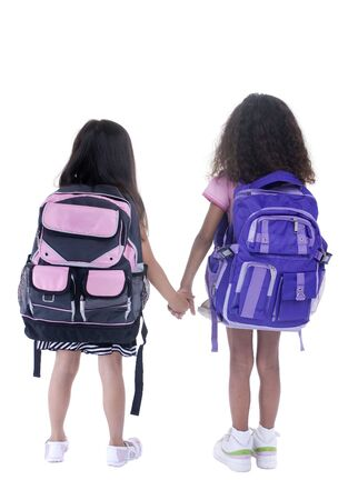 Going to school is your future. Education, learning, teaching. Two young girls head off to school. Stockfoto