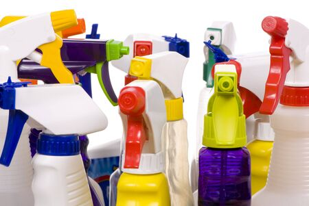 An assortment of different types of cleaning sprays. photo