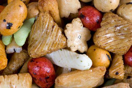 A mixture of different crunchy snacks. Macro Standard-Bild - 3485102