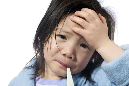 A young girl is sick and having her temperature taken. Stockfoto