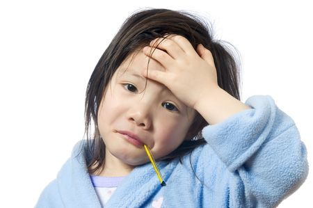 sick in bed: A young girl is sick and having her temperature taken. Stock Photo