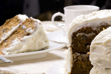 A slice of fresh carrot cake with a cup of coffee. photo